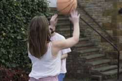 Gemma taking a shot in basketball