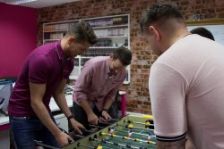 Duncun, Andy U, Andy S and Jeremy playing foosball